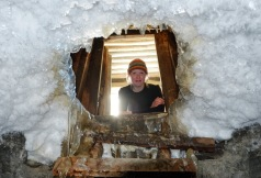 """Sandra looking down in our """"freezer"""": a cave dug in the permafrost!"""
