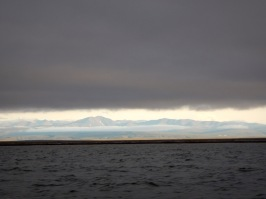 The British mountains on the Coast of the Yukon Territory in the sunshine when Qikiqtarȓuk was still in the clouds on our boat ride.