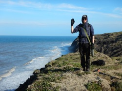Santo waving from the East coast of the island – I think it looks a bit like the coast of California with high cliffs and big waves – though these cliffs are made of just mud and permafrost!