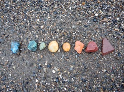 Isla's collection of rainbow rocks.