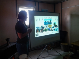 A Team Shrub presentation on the island sharing research findings to visitors and other community members.