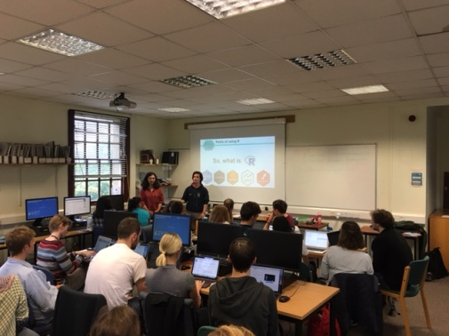 Sam and Claudia leading Coding Club in front of a room packed with people keen to learn R! https://ourcodingclub.github.io/
