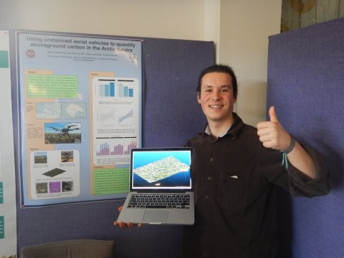 Sam presenting a poster about his undergraduate dissertation research on carbon storage in the aboveground biomass on Qikiqtaruk-Herschel Island