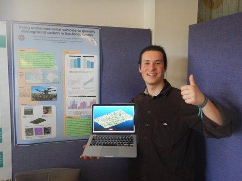 Sam presenting a poster about his undergraduate dissertation research on carbon storage in the aboveground biomass on Qikiqtaruk-Herschel Island