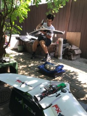 Noah mounting the Parrot Disco fixed-wing with the Sequoia multispectral camera